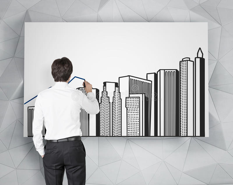 Businessman drawing buildings. Businessman drawing chart and buildings on poster stock photography