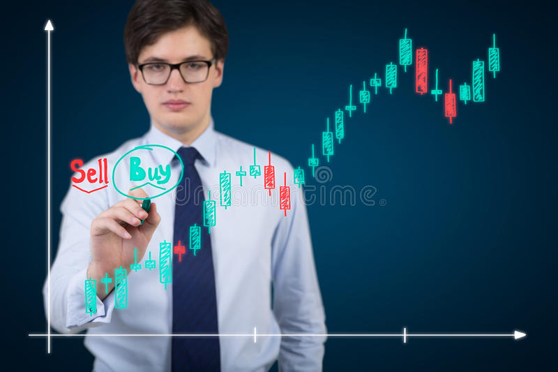 Businessman drawing chart. Businessman drawing stock chart isolation on blue royalty free stock images