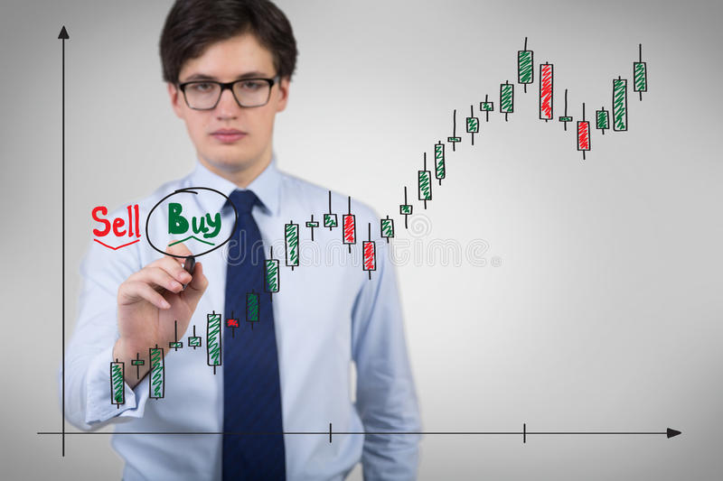 Businessman drawing chart. Businessman drawing stock chart isolation on gray stock image