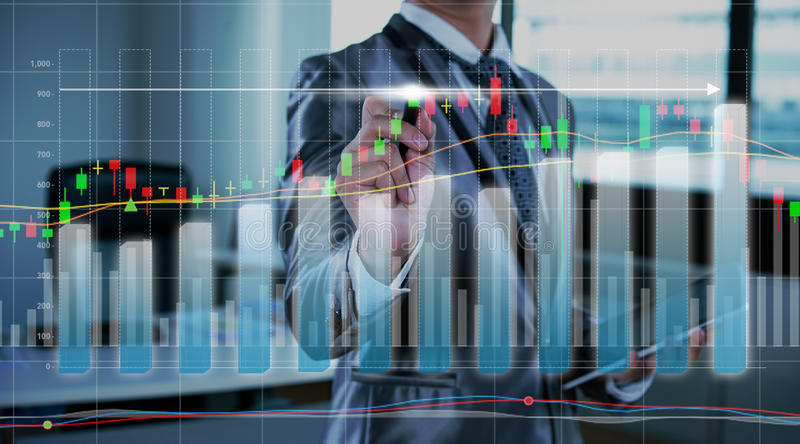 Businessman drawing chart, stock marketing concept royalty free stock photography