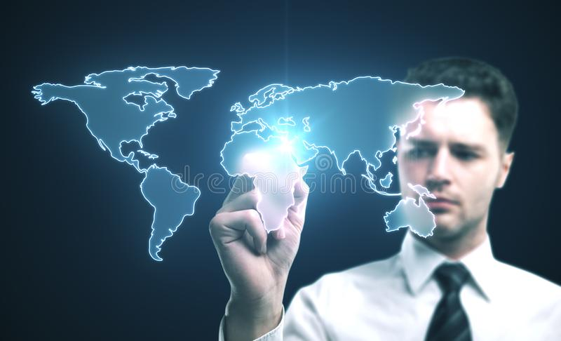 Businessman drawing digital world map. On glass screen. Close up stock photos