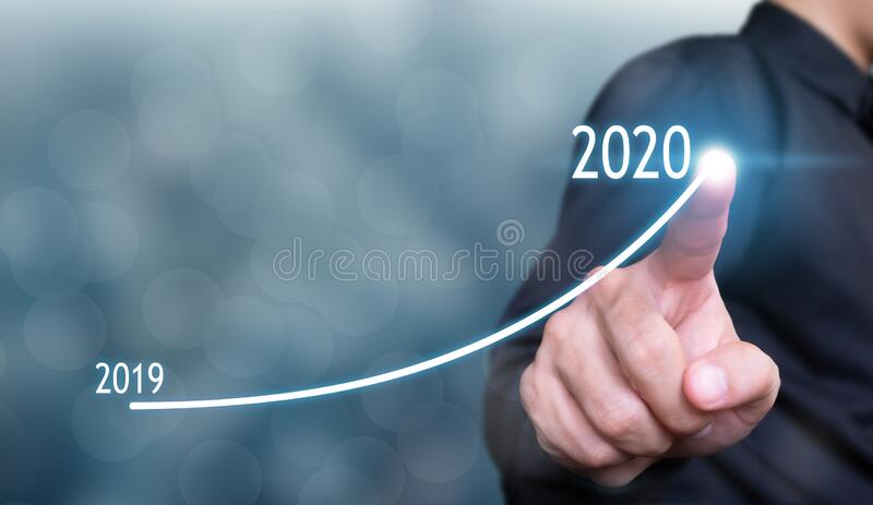 Businessman drawing graph in growth 2020 concept , business growth concept , finance concept stock image