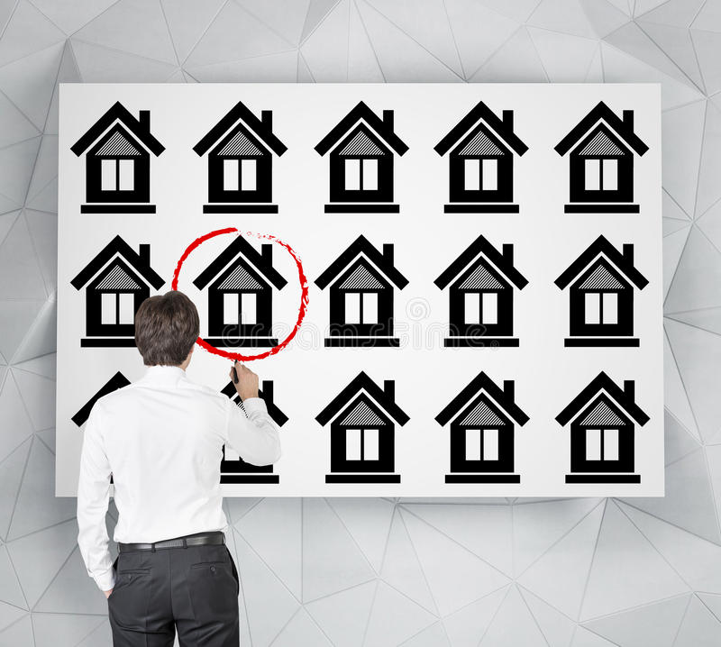 Businessman drawing house royalty free stock photography