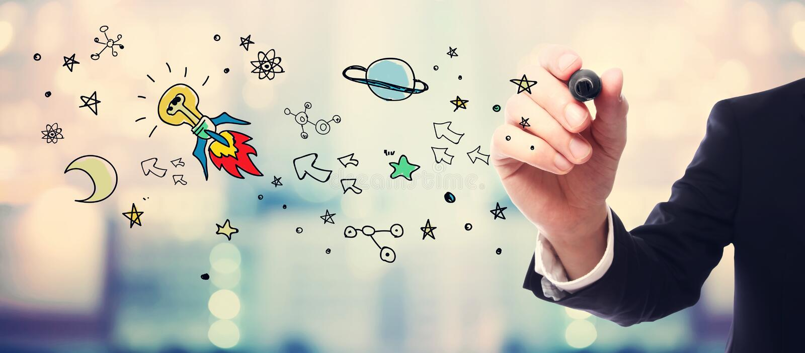 Businessman drawing Idea Rocket concept royalty free stock photography