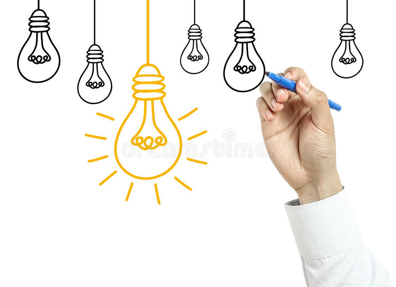 Businessman drawing light bulb concept stock photo