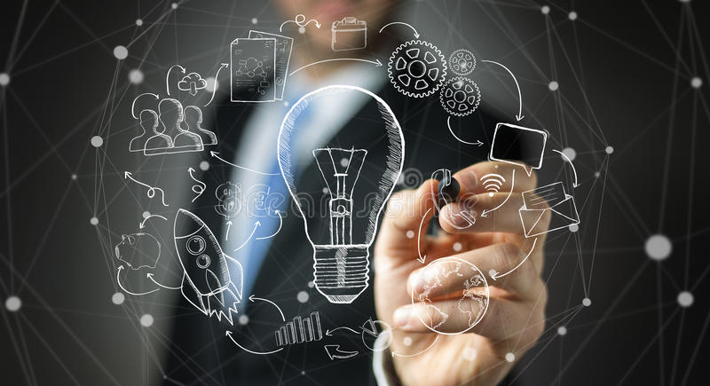 Businessman drawing a lightbulb with a pen with multimedia icons royalty free illustration