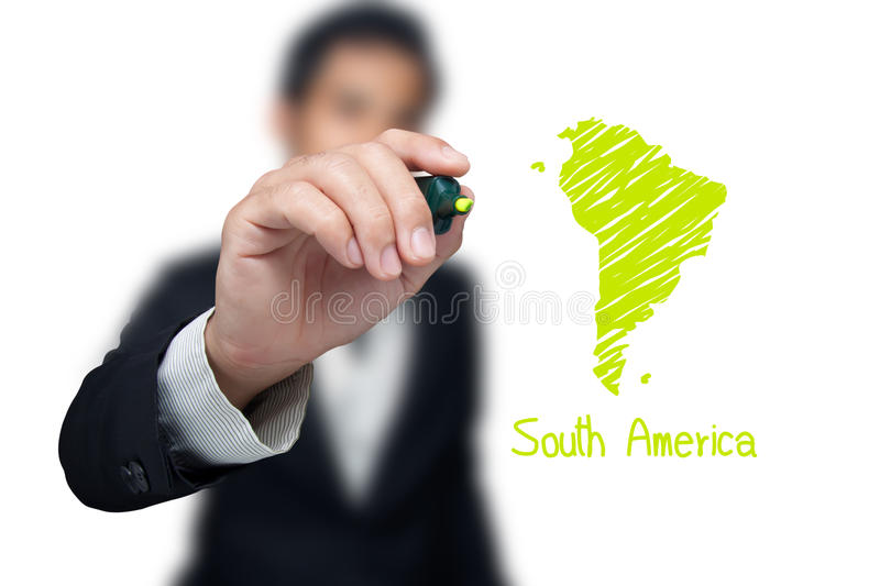 Businessman drawing a map. Businessman drawing a map of continent South America royalty free stock photos