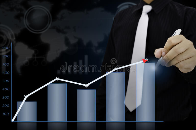 Businessman drawing present info graphs.  royalty free stock photography