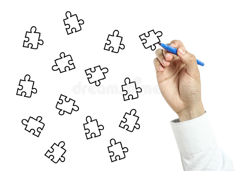 Businessman drawing puzzles stock photography