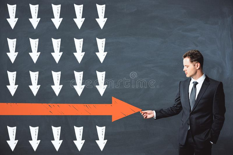 Leadership and win concept. Businessman drawing red arrow on chalkboard wall background. Leadership and win concept vector illustration