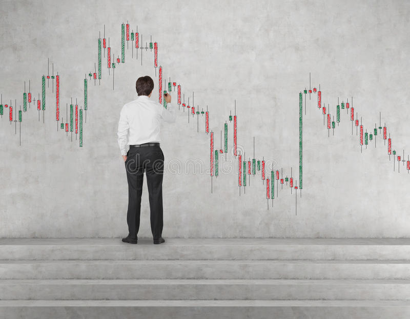 Businessman drawing stock chart. On wall royalty free stock photo