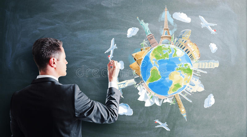 Businessman drawing travel stock photography