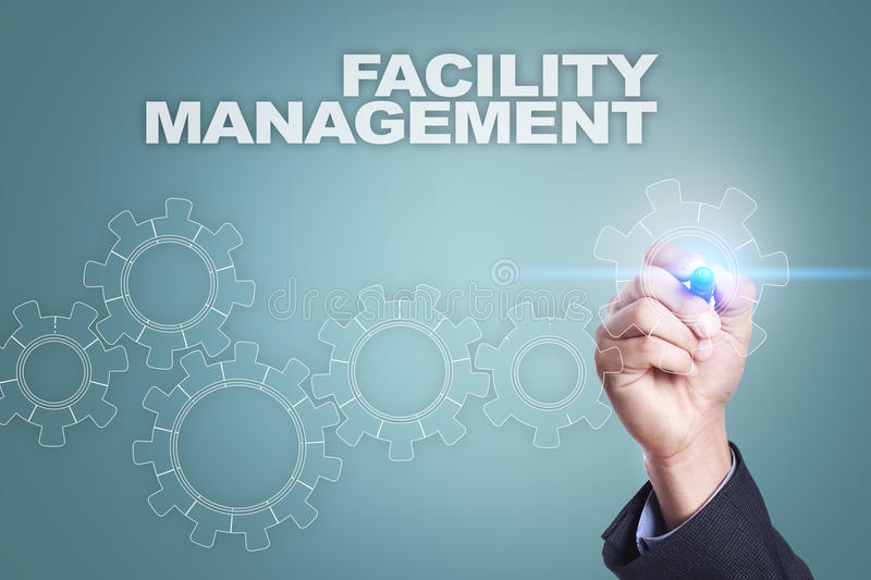 Businessman drawing on virtual screen. facility management concept.  stock photo