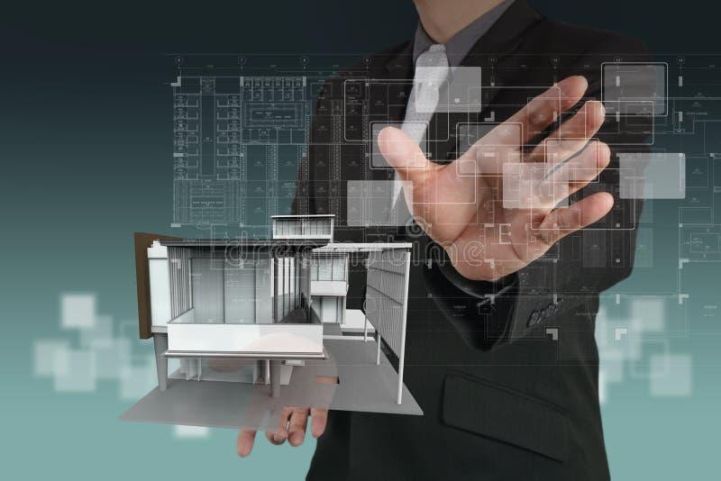 Businessman draws building development stock illustration