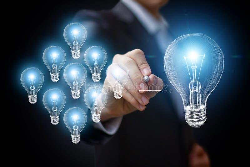 Businessman draws a light bulb. stock illustration