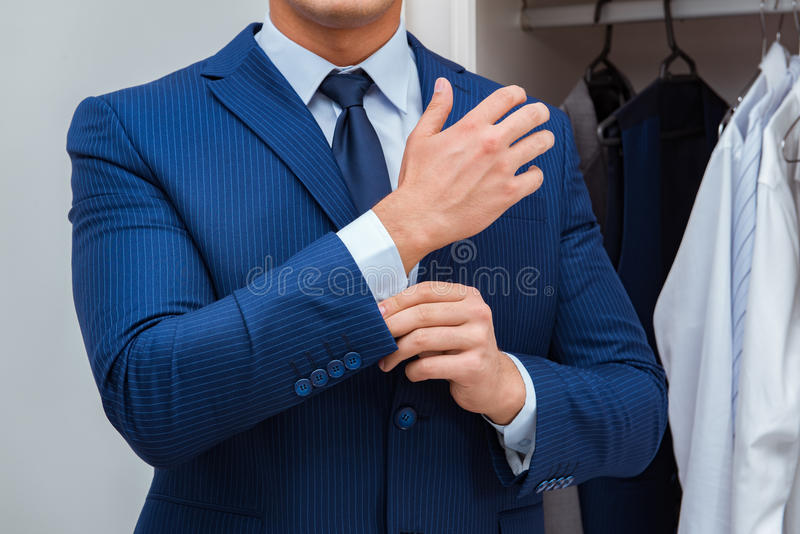 The businessman dressing up for work. Businessman dressing up for work royalty free stock image