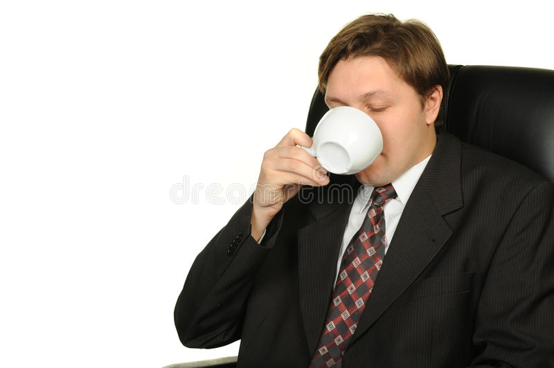 The businessman drinking coffee royalty free stock image