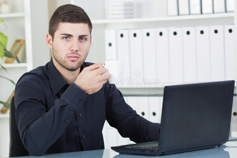 Download Businessman Drinking Coffee In His Office Stock Photo - Image of laptop, network: 31894218