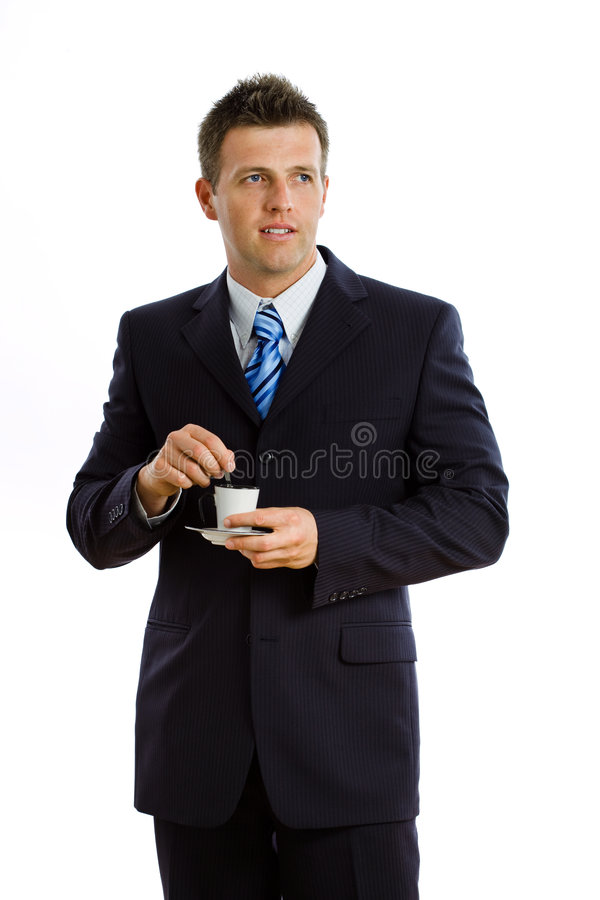 Businessman drinking coffee isolated stock images