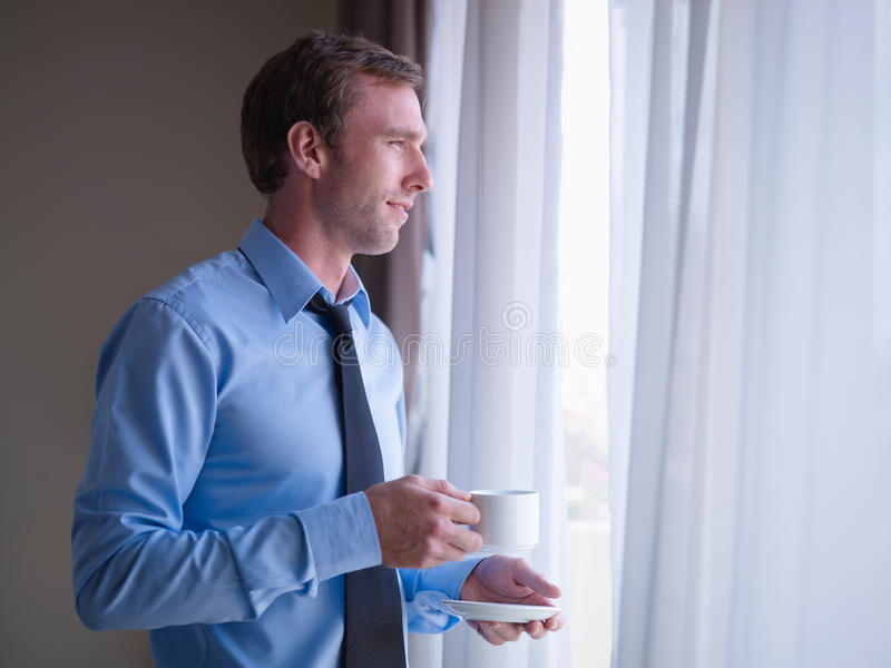 Download Businessman Drinking Coffee And Looking Outside Stock Image - Image: 22933181