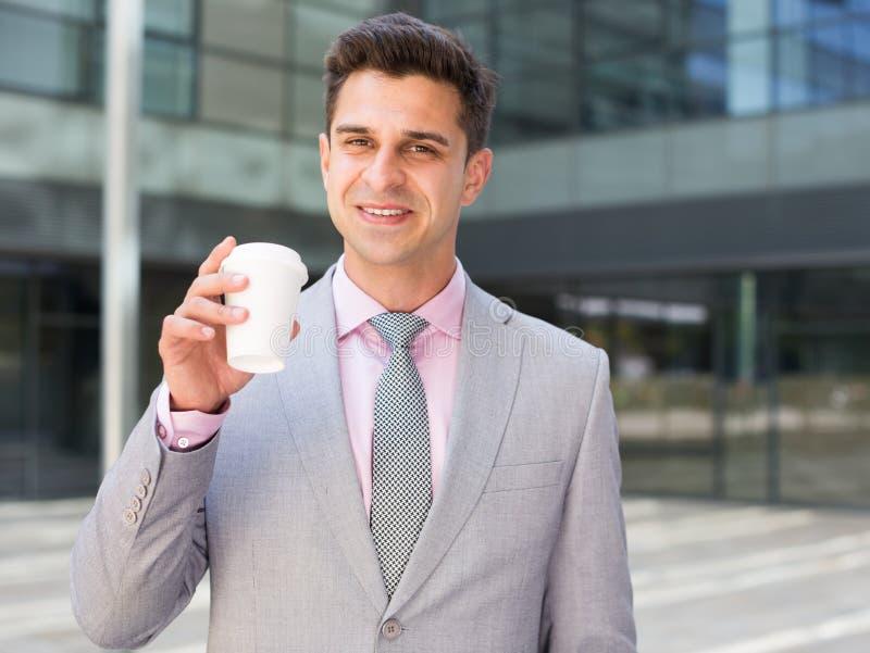 Businessman drinking coffee stock photography