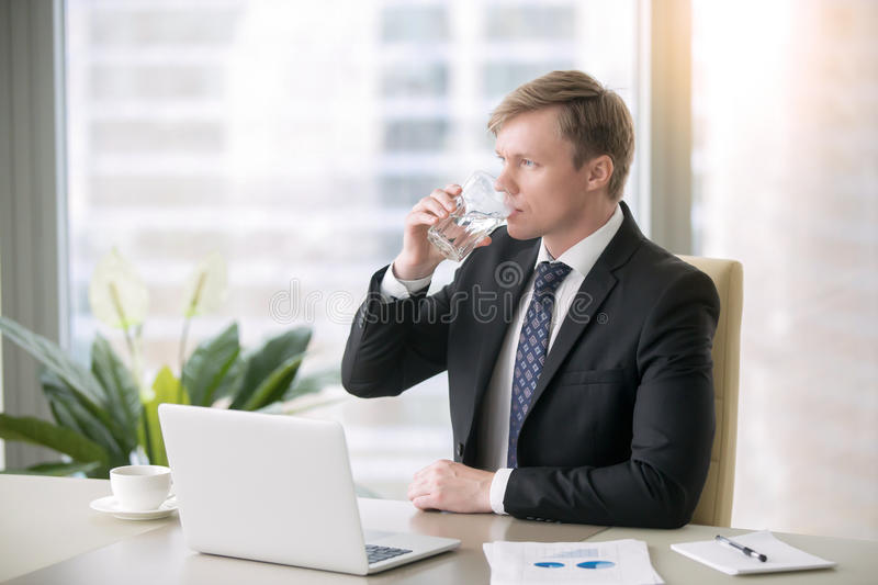 Businessman drinking water royalty free stock photography