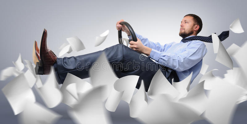 Businessman driver flying with paper royalty free stock photography