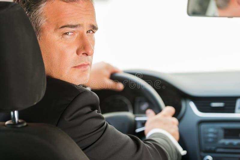Businessman driving car. royalty free stock photos