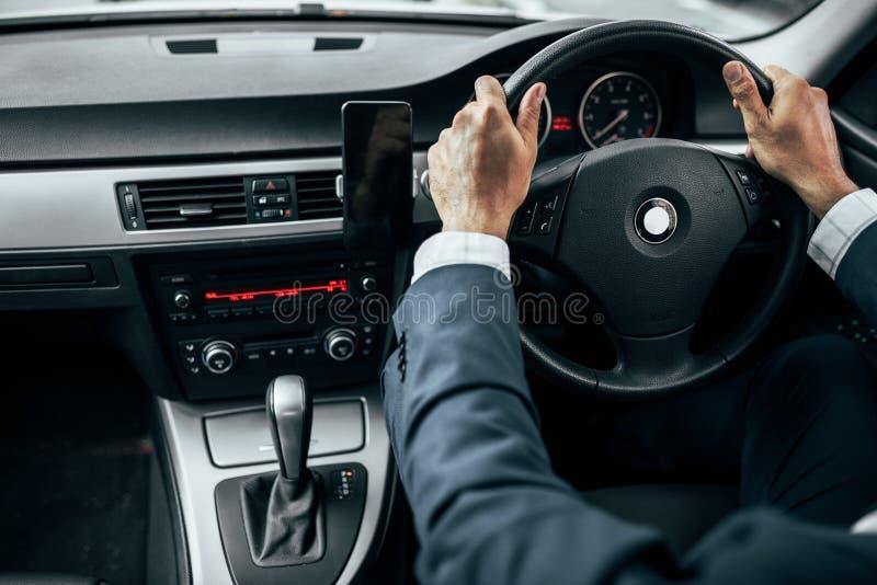 Businessman driving car stock photos