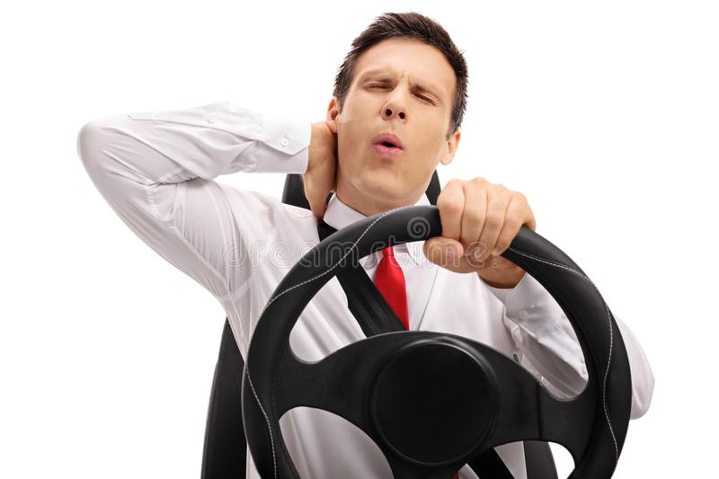 Businessman driving and experiencing neck pain. Isolated on white background stock images