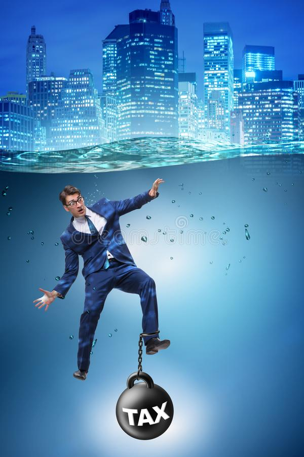 The businessman drowning in concept of high taxes. Businessman drowning in concept of high taxes royalty free stock photography
