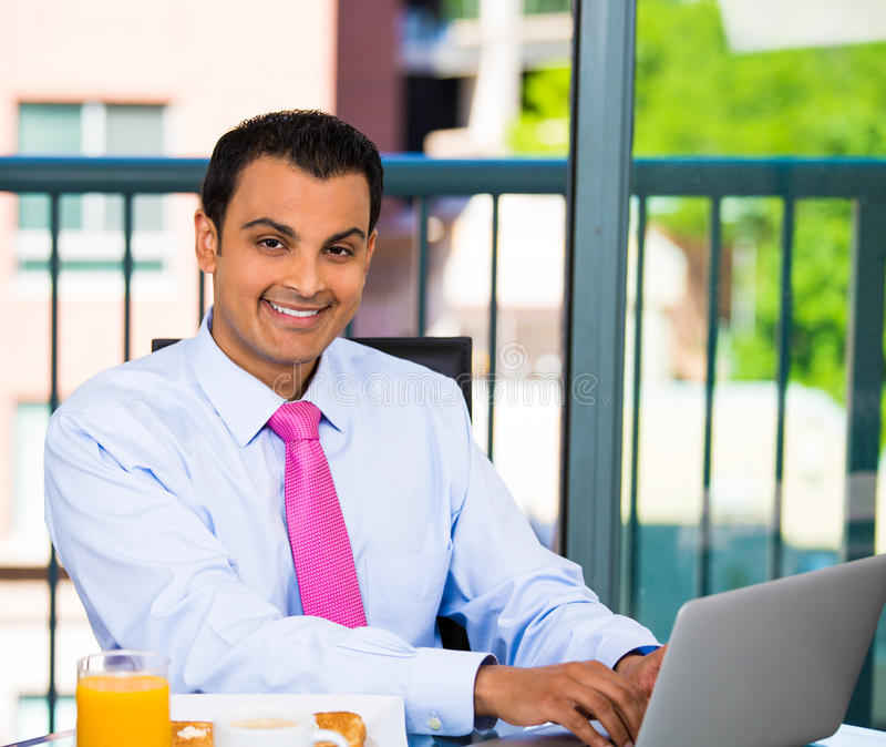 Businessman eating breakfast stock images