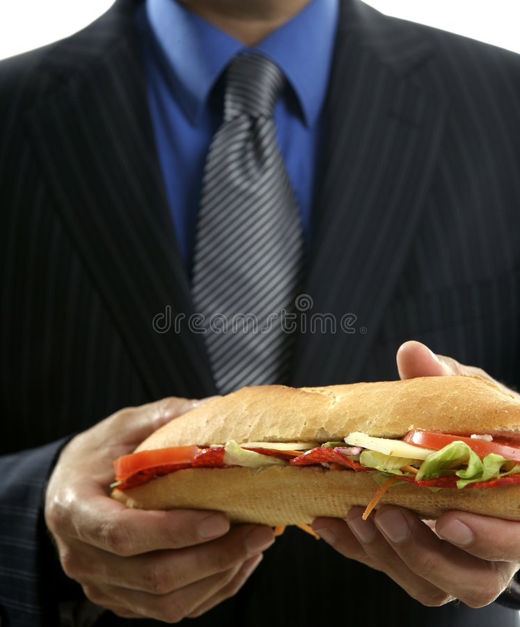 Businessman eating junk fast food royalty free stock image