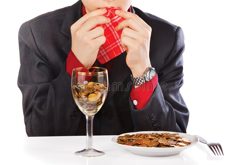 Businessman eating money stock photography