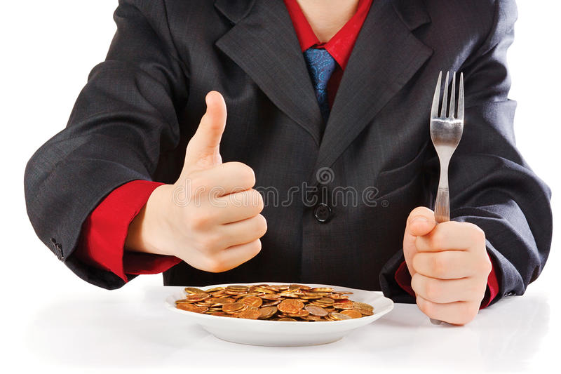 Businessman eating money stock photos
