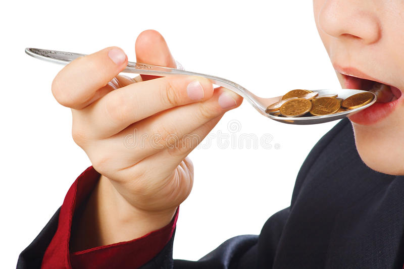 Businessman eating money royalty free stock photo