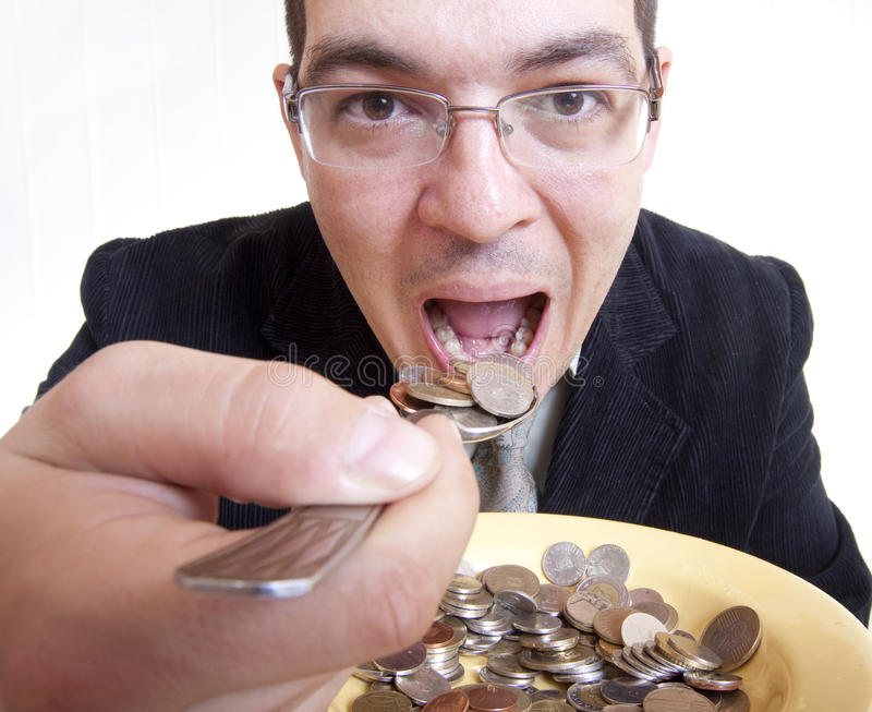 Businessman eating money stock images