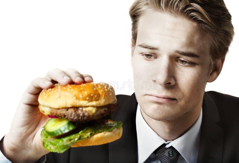Businessman eating at work stock image