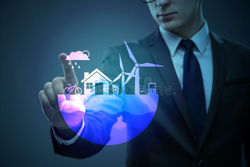 The businessman in ecological green concept stock photos