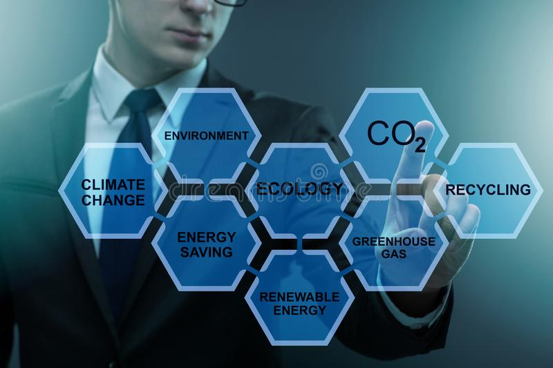 The businessman in ecology and environment concept stock photo