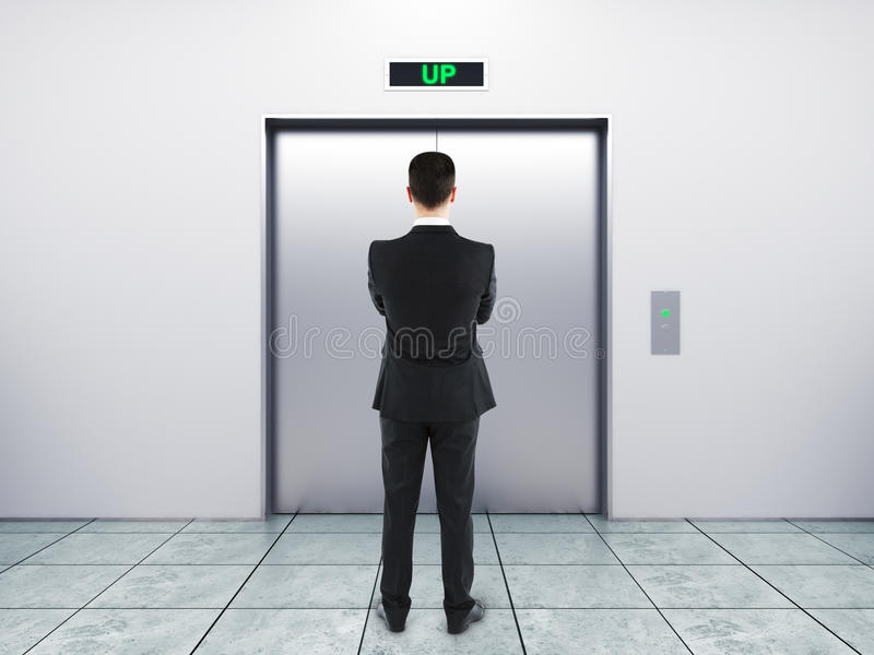 Businessman and elevator stock photography