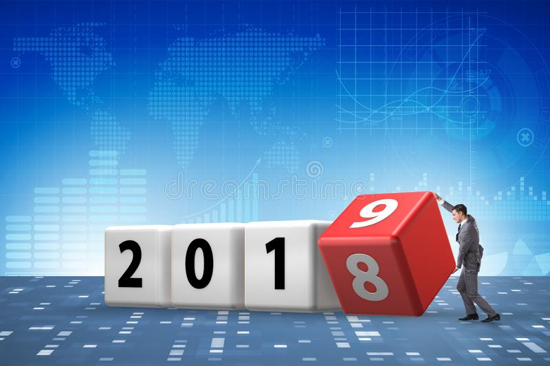 The businessman employee rotating cube to reveal number 2019. Businessman employee rotating cube to reveal number 2019 royalty free stock image