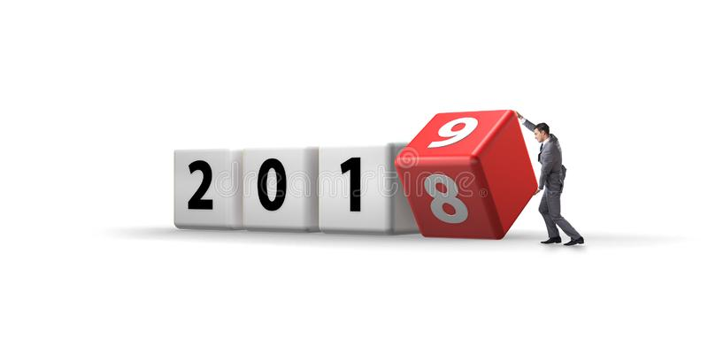 The businessman employee rotating cube to reveal number 2019. Businessman employee rotating cube to reveal number 2019 stock image