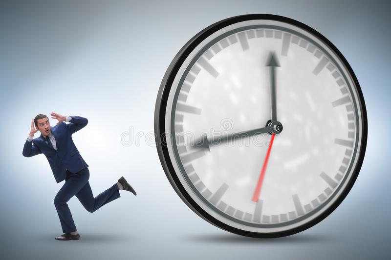 Businessman employee in time management concept. The businessman employee in time management concept stock images