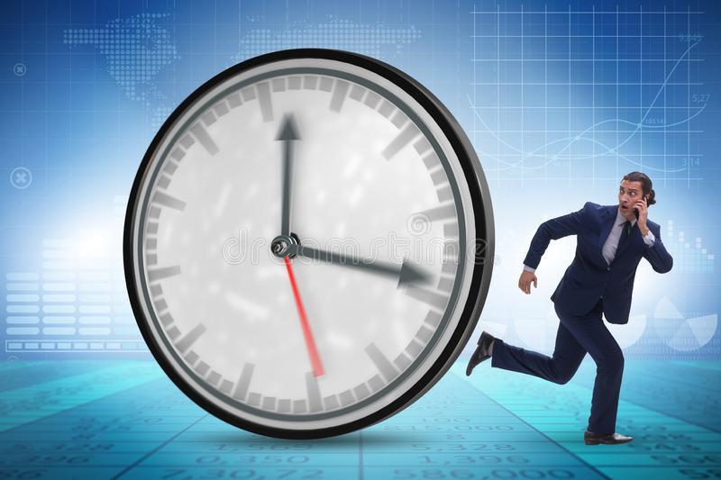 Businessman employee in time management concept. The businessman employee in time management concept royalty free stock images