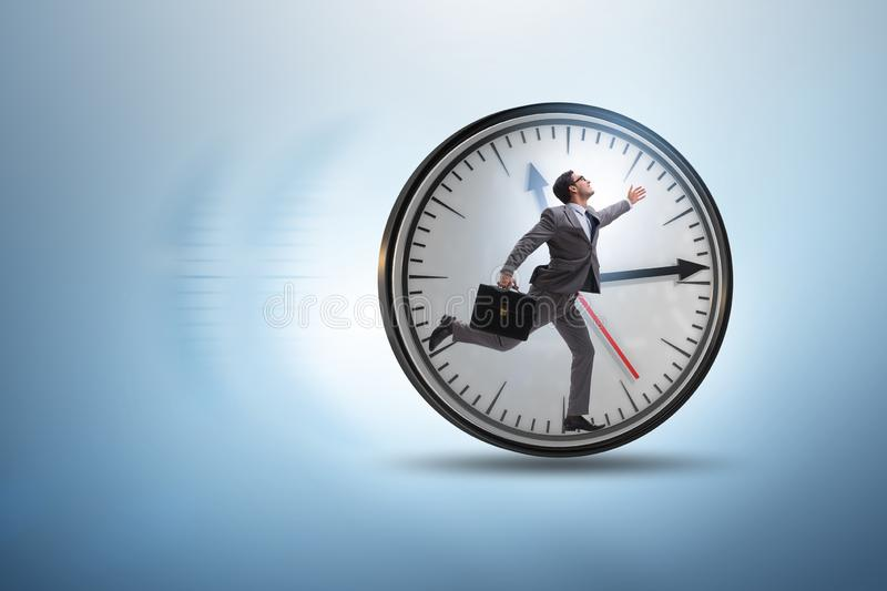 Businessman employee in time management concept. The businessman employee in time management concept royalty free stock photos