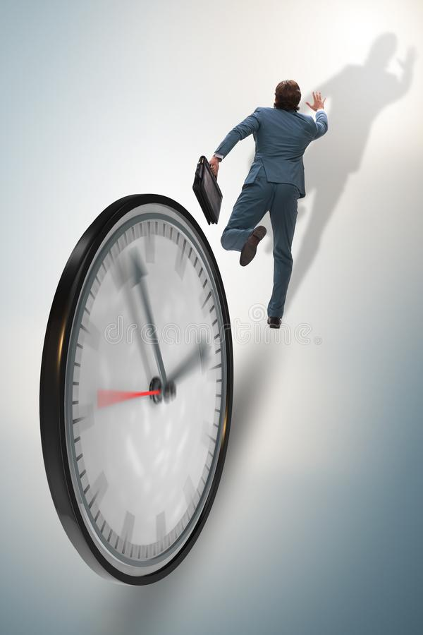 Businessman employee in time management concept. The businessman employee in time management concept royalty free stock photo