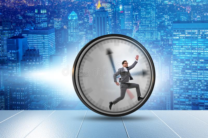 Businessman employee in time management concept. The businessman employee in time management concept stock image