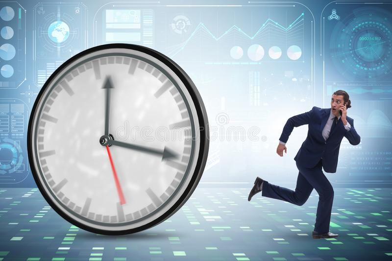 Businessman employee in time management concept. The businessman employee in time management concept stock photos