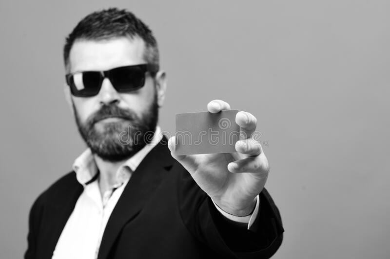 Businessman with empty card and copy space. Man with beard stock image
